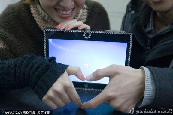 iPad savo rankomis