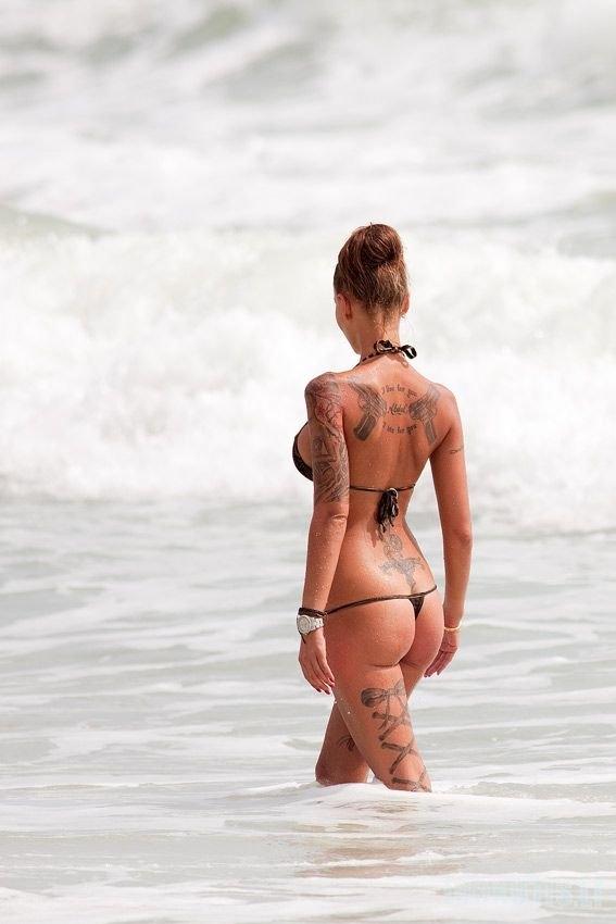 Tatuiruota mergina (7 nuotraukos)