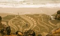 Nauji Andres Amador gigantiški piešiniai ant smėlio