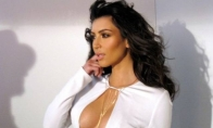 Kodėl Kim Kardashian papai visada atrodo tobulai?