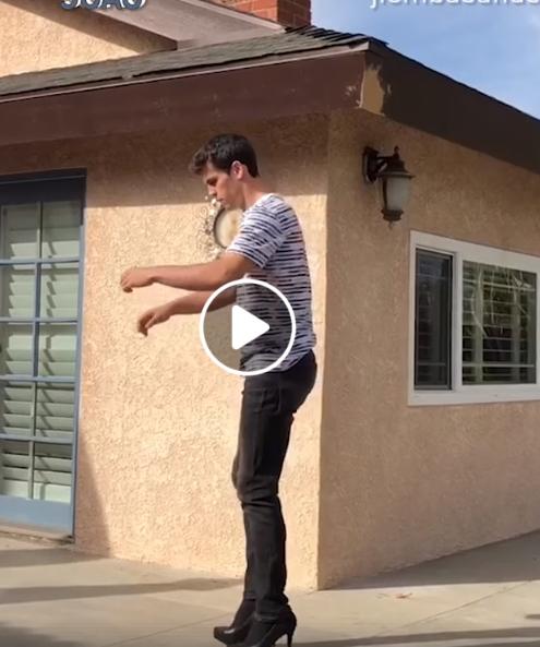 Vaikinas padaro atbulinį salto su aukštakulniais