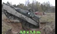 Kaip tankas įveikia apkasus